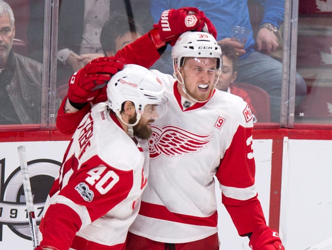 Detroit Red Wings' Anthony Mantha, right, celebrates