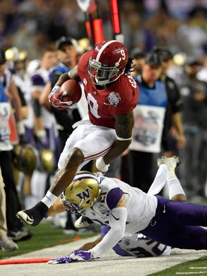 Alabama Crimson Tide running back Bo Scarbrough (9) is knocked out of bounds by Washington Huskies defensive back Taylor Rapp (21) during the first quarter in the 2016 CFP semifinal at the Peach Bowl at the Georgia Dome.