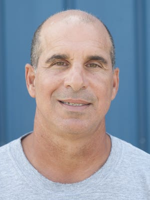 Pete Lancetta, shown here in a 2014 file photo as head football coach at Hammonton High School, was hired as St. Augustine's next head coach on Wednesday.