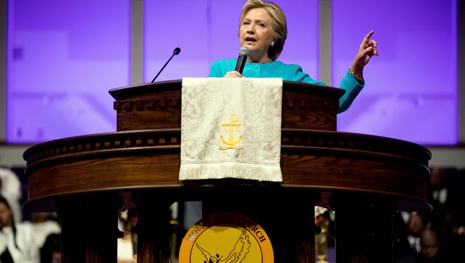 In this Nov. 6, 2016 file photo, then-Democratic presidential candidate Hillary Clinton speaks at Mt Airy Church of God In Christ in Philadelphia. President Donald Trump on Thursday, May 4, 2017, signed a new executive order aimed at weakening the enforcement of a law that bars churches and tax-exempt groups from endorsing political candidates. A look at the law in question, known as the Johnson Amendment.