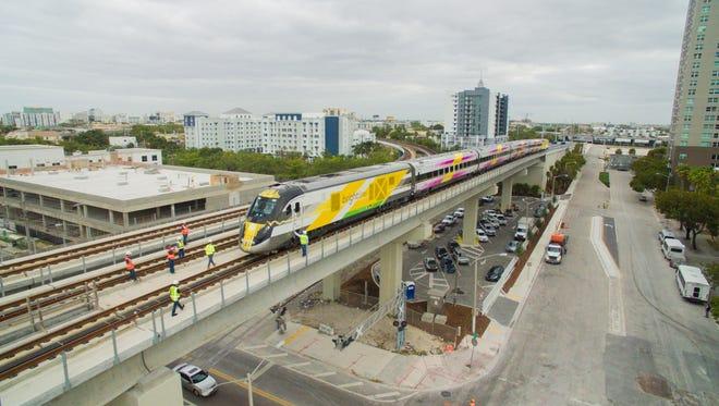A Brightline train approaches MiamiCentral station.