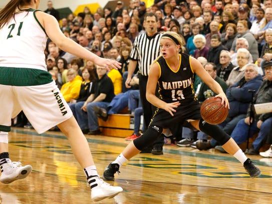 Danielle Hopp of the Waupun girls basketball team moves