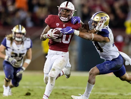 Stanford running back Bryce Love carries the ball during