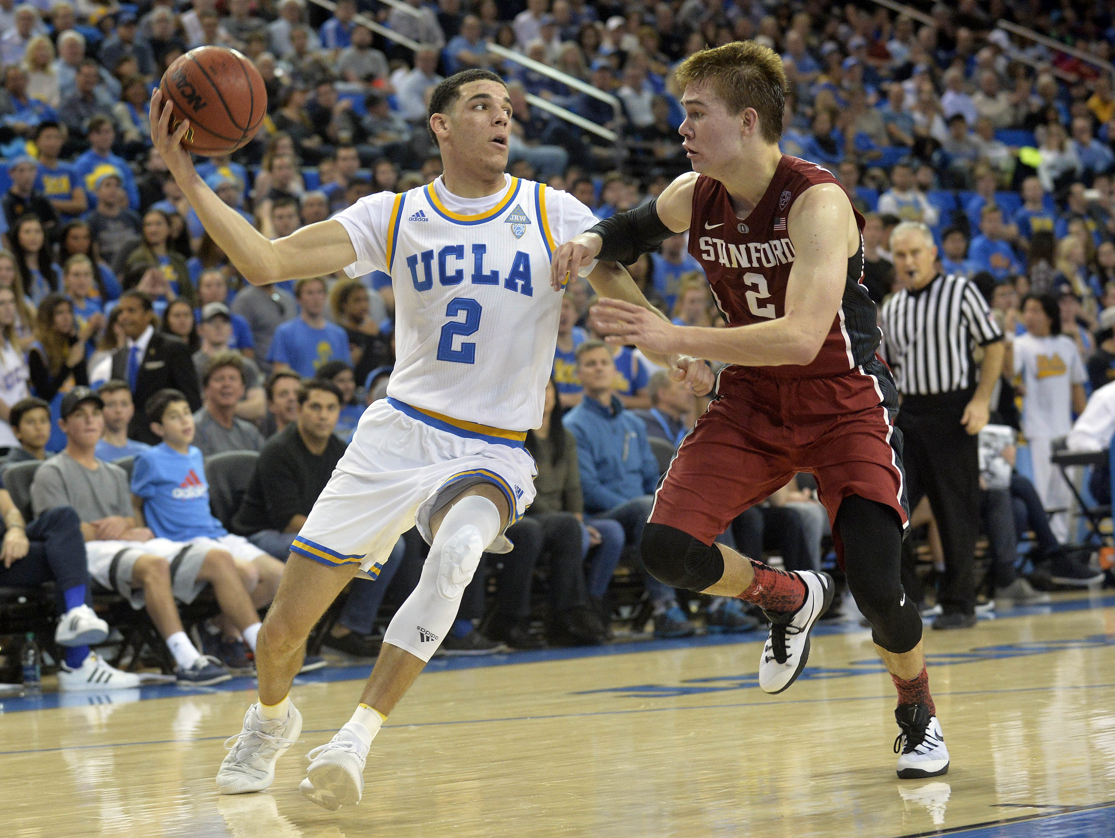 UCLA Bruins guard Lonzo Ball (2) moves the ball against the defense of Stanford Cardinal guard Robert Cartwright (2). He scored 21 in UCLA?s 89-75 win. January 8, 2017; Los Angeles, CA, USA; UCLA Bruins guard Lonzo Ball played in the 2015 Bass Pro Tournament of Champions for Chino Hills (Chino Hills, California)