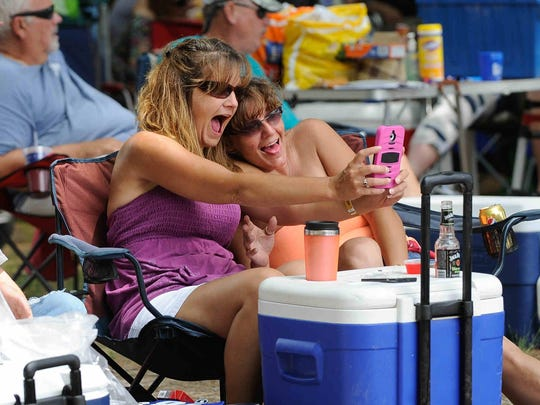 Lisa Robinson, left and Polly King of Seaford take a selfie together at the 37th annual June Jam in Houston.
