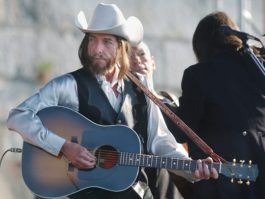 Bob Dylan, sporting a wig, performs at the Newport Folk Festival in 2002.