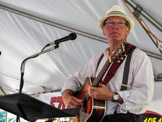 Kevin Lorenz plays guitar at the Sourwood Festival