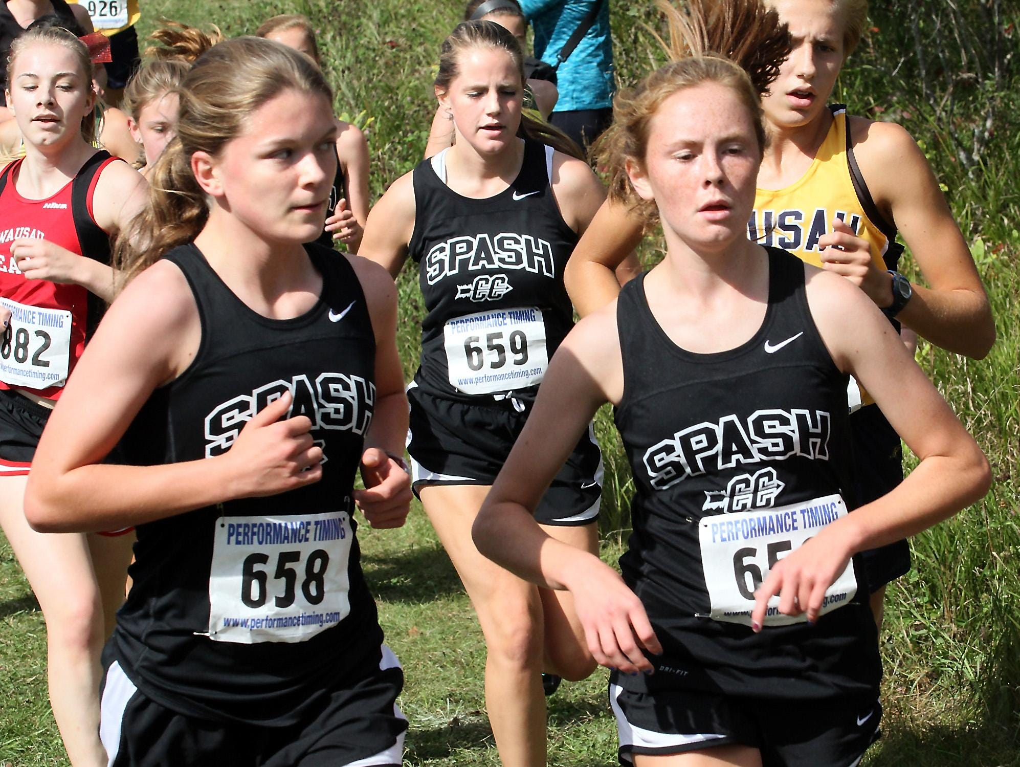 Autum Shurbert-Hetzel, SPASH, left, runs with her teammates Erica Vanhelden and Kimby Klein during the the SPASH Invitational Saturday at Standing Rocks County Park near Plover.
