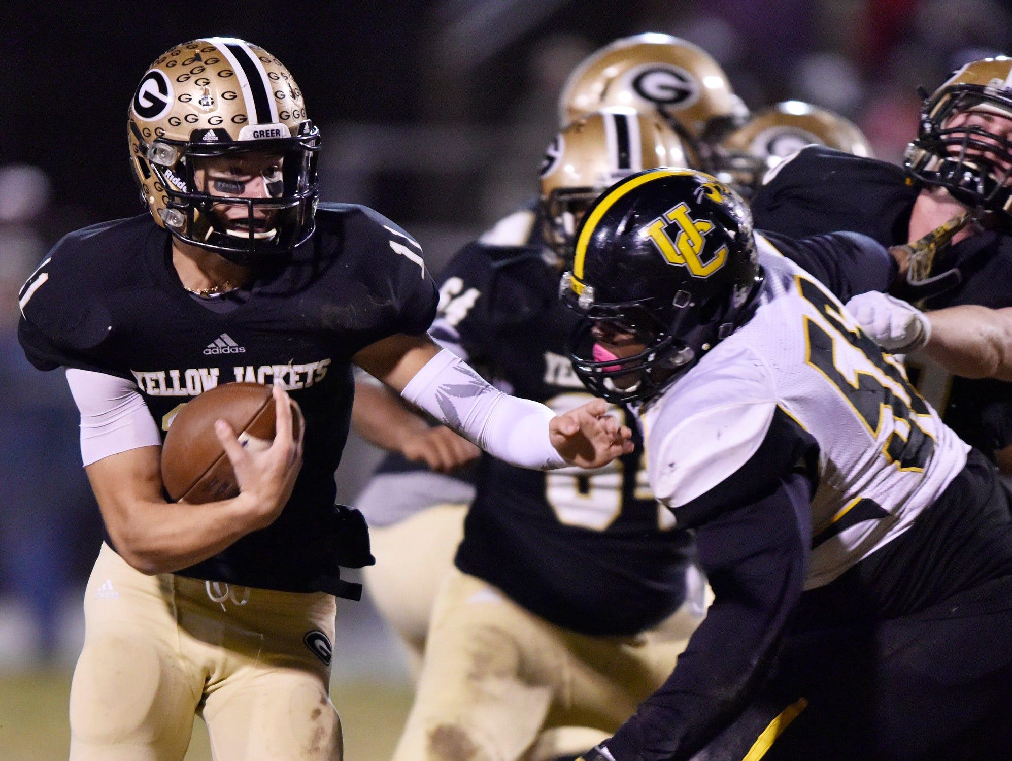 Greer quarterback Mario Cusano (11) evades a Union County defender.