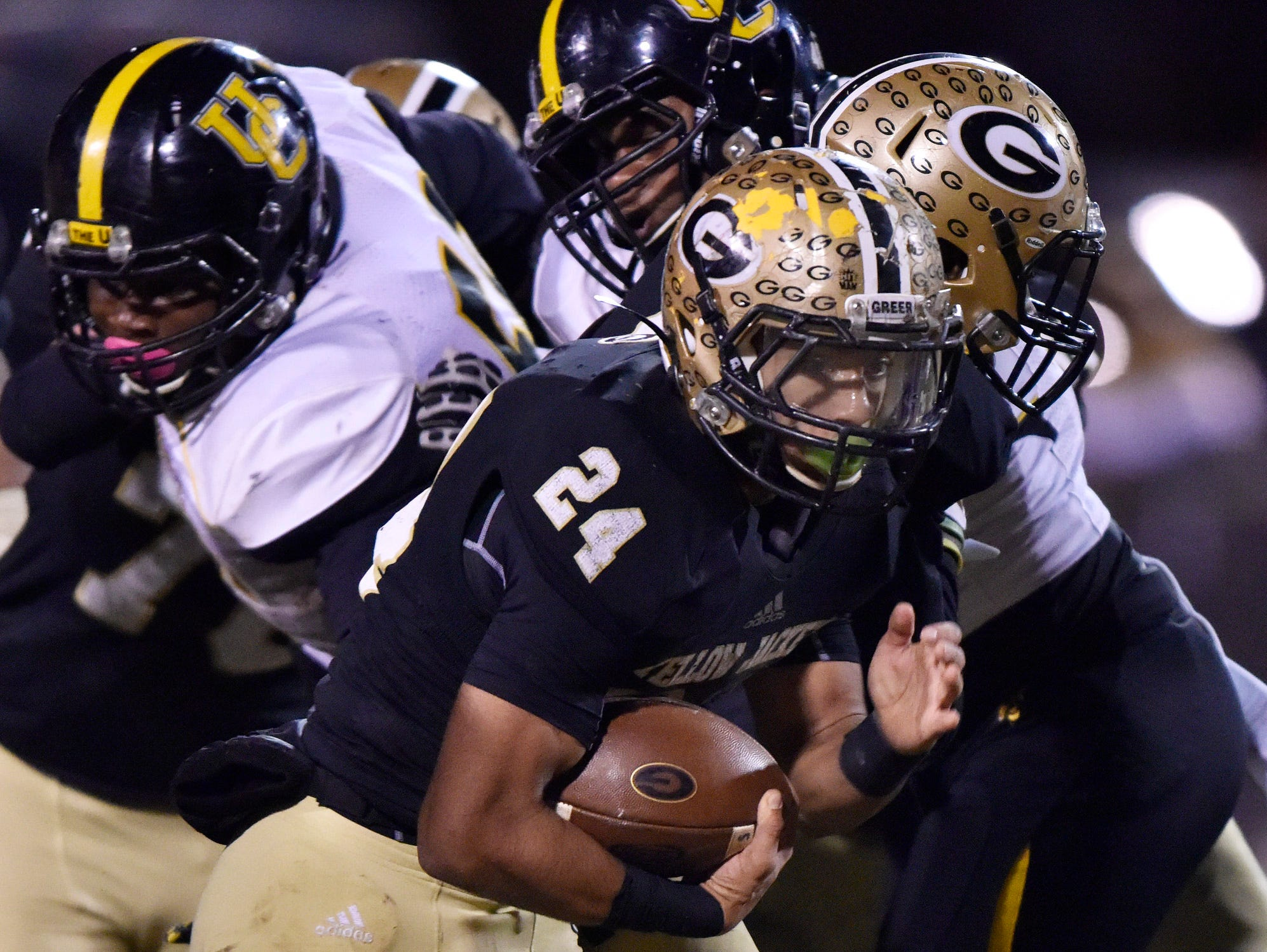 Greer's Adrian McGee (24) sneaks through the Union County defense.