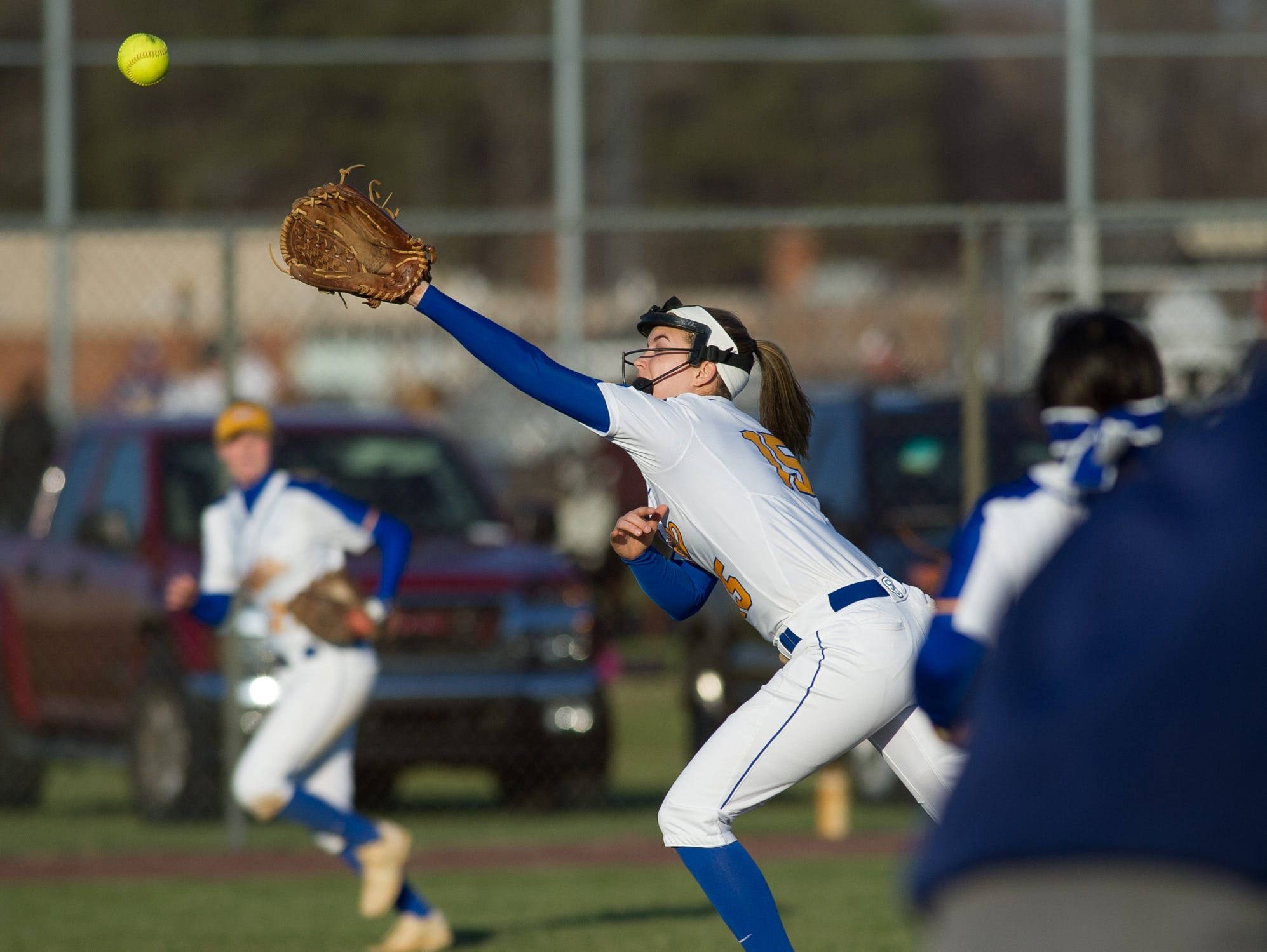 Sussex Central's Brooke Stoeckel (15) jumps in the air trying to catch a hit by Sussex Tech.