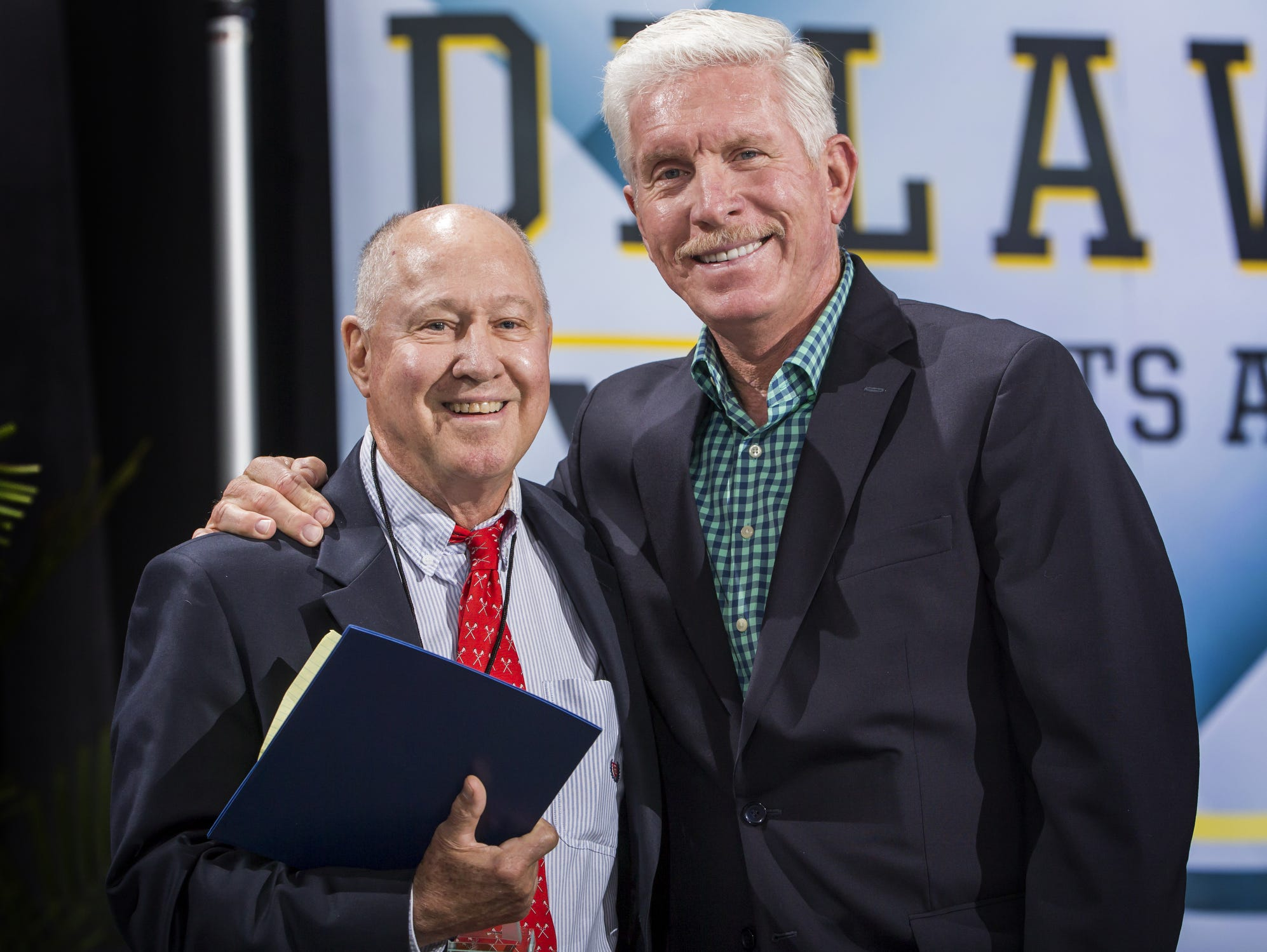 Cape Henlopen Girls Lacrosse Coach PJ Kesmodel poses with Mike Schmidt after being named the coach of the year at the Delaware Sports Awards banquet at the Bob Carpenter Center at the University of Delaware in Newark on Wednesday evening.
