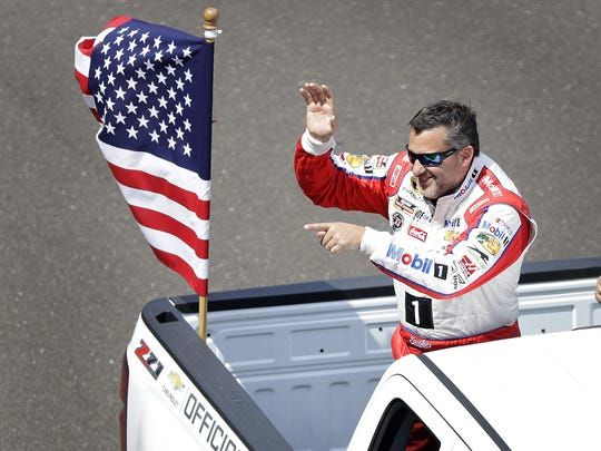 Sprint Cup Series driver Tony Stewart (14) on the parade lap before the start of the Brickyard 400 Sunday, July 24, 2016, afternoon at the Indianapolis Motor Speedway.