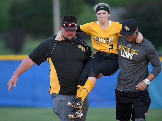 Scotts Hill's Chelsey Gore (2) is carried off the field by her coaches Tyler Sowell, left, and Daniel Duncan at Jackson Christian's Warner Taylor Field in Jackson, Tenn., on Tuesday, April 18, 2017.