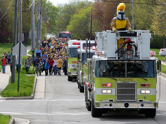 Waupun Area School District students were escorted from the Rock River Intermediate School to the Waupun Jr./Senior High School Wednesday by Waupun and Alto Fire Departments as part of a ground breaking ceremony for the new athletic complex at the Junior/Senior High School.