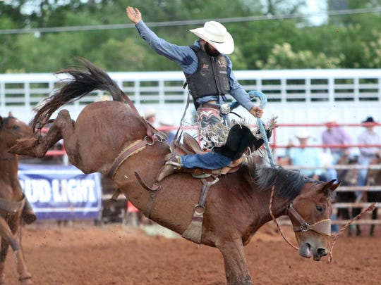 Lewis Agaiore competes in saddle bronc riding Saturday, June 3, 2017, at the Mounted Patrol Championship Rodeo in the Mounted Patrol Arena on FM 369.