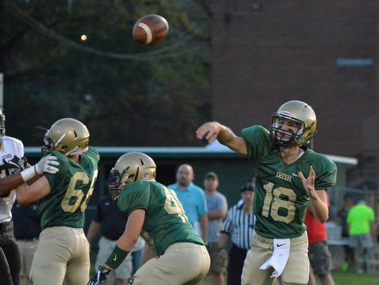 York Catholic quarterback Wesley Burns completes a