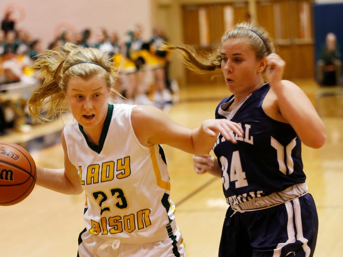 Emma Fisher of Benton Central tries to drive past Jennifer