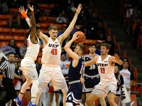 UTEP defenders surround Miles Lester, 11, of Rice when