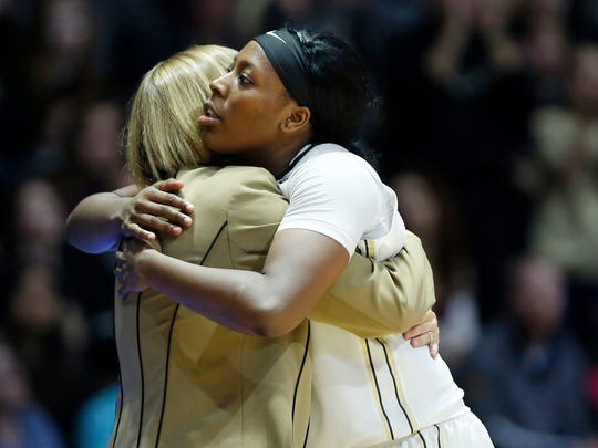 Senior Andreona Keys embraces head coach Sharon Versyp as she leaves the game for the final time at Mackey Arena as the Boilermakers fall to Michigan State 82-68 Saturday, February 24, 2018.