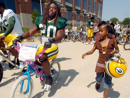 Green Bay Packers players connect with young fans in many ways, including the bike-riding tradition at training camp.