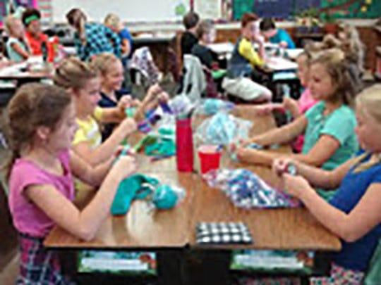 South Elementary's Mrs. Karla Reynolds' 4th grade class working on belt weaving.
