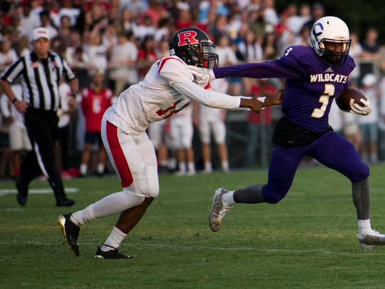 Clarksville High Joshua Watch runs away from a Rossview