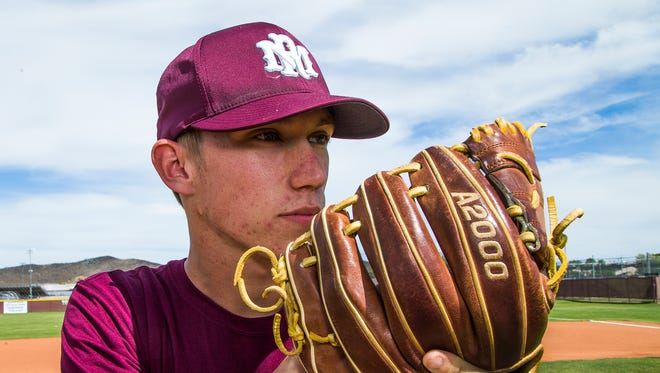 Tommy Lowe, 18, is a pitcher for Mountain Ridge High School in Glendale, who found out he has Type 1 diabetes. He practices his pitching motions at the school, Tuesday, April 4, 2017.