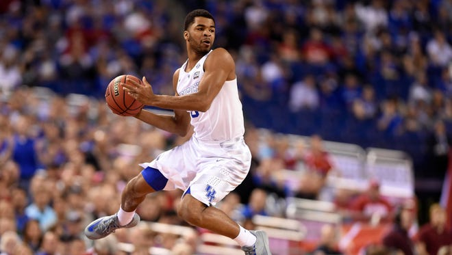 Apr 4, 2015: Kentucky Wildcats guard Andrew Harrison (5) saves the ball from going out of bounds against the Wisconsin Badgers in the first half of the 2015 NCAA Men's Division I Championship semi-final game at Lucas Oil Stadium.