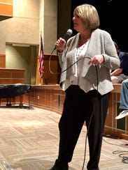 Assistant Superintendent Cathy Dusman speaks to a group