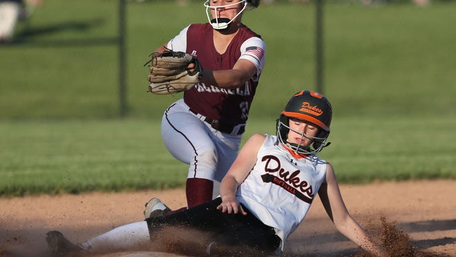 Marlboro's Kasey Conn slides safely into second as Valhalla's Christina Ferrara applies the late tag during a Class B regional semifinal Thursday at Middletown High School. The Iron Dukes overcame an early three-run deficit to win.