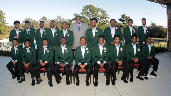 U.S. Rep. Al Lawson with 18 high school seniors at the 8th Annual Links Beautillion Green Coat Ceremony Sunday, Jan. 14, 2018.