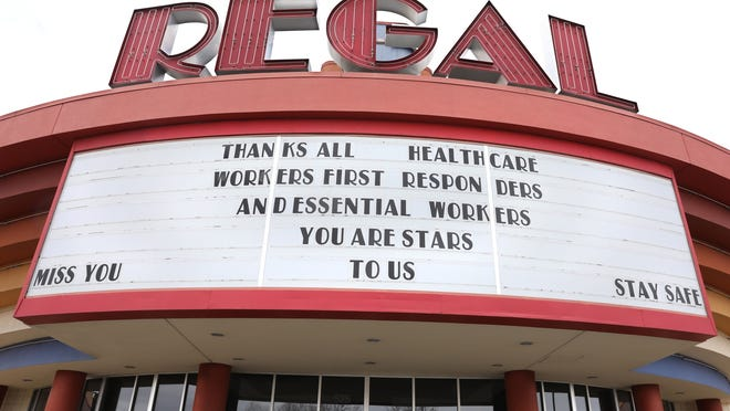 A message of thanks to healthcare workers, first responders and essential workers is seen on the sign at Regal Henrietta Cinema 18 in April. Movie theaters across the country are closed due to the coronavirus pandemic.