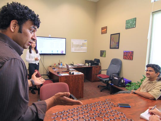 Ramakrishna Podila, left, assistant professor, talks with  Apparao Rao, right, director, near Jingyi Zhu, middle, doctoral candidate, Wednesday at the Clemson University Nanomaterials Center near Pendleton.