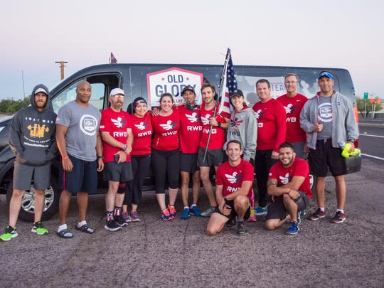 Shawn Cleary (holding flag in center) delivers the flag to the Tucson Team RWB near Picacho Peak in the early morning hours of Oct. 5, 2016. The flag completes its 4,216-mile journey in Tampa on Veterans Day, Nov. 11.