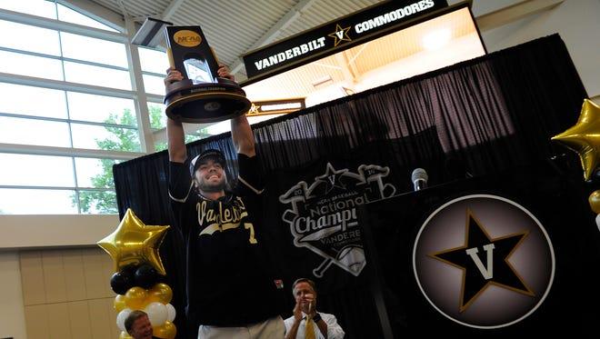 Vanderbilt infielder Dansby Swanson holds up the NCAA Championship trophy during a celebration Thursday at Vanderbilt.