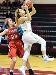 Comanche's Jilian Hufstutler drives to the hoop while