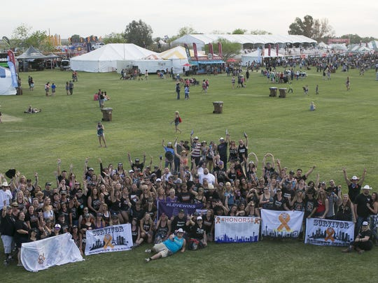 Survivors of the Route 91 Harvest Music Festival shooting  in Las Vegas gather for a group photo at Country Thunder Arizona on Friday, April 6, 2018.