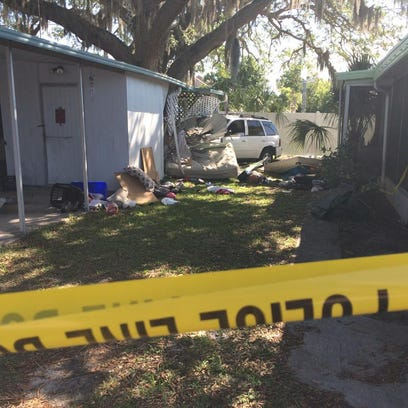 A man and woman asleep in their Palmetto mobile home