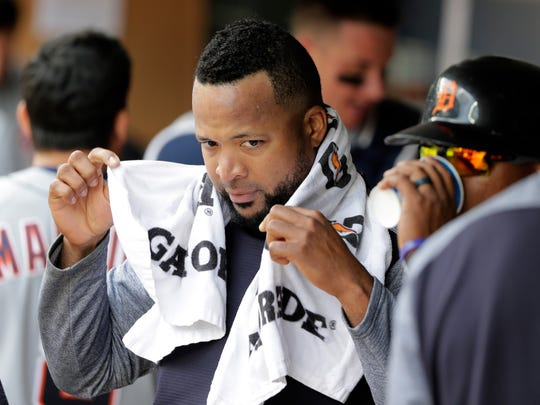 Detroit Tigers starting pitcher Francisco Liriano holds
