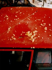 The roof of this red car was struck by a meteorite