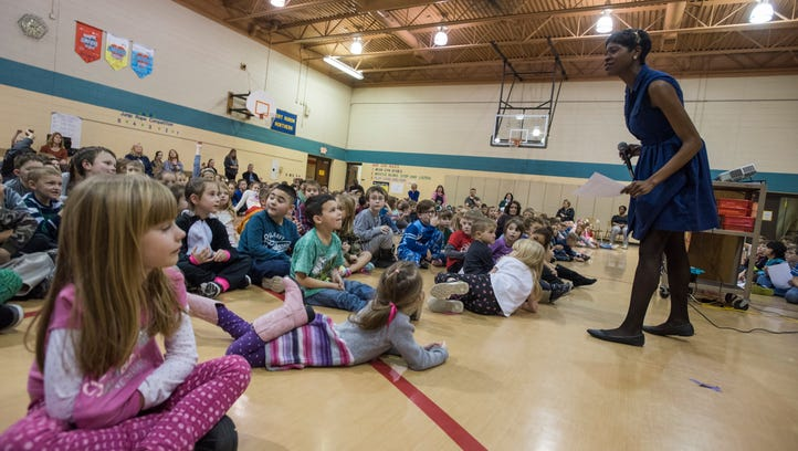 Cece Sumpter, college advisor for Port Huron Northern, talks to the students about making good choices and being nice to people Monday, Jan. 16, at Michigamme Elementary School.