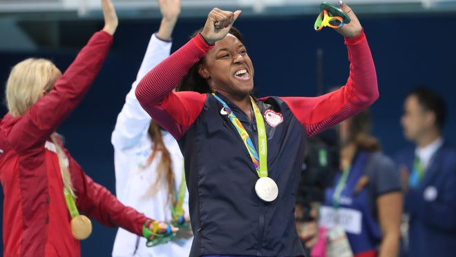 Simone Manuel (USA) with her silver medal after the women's 50m freestyle final in the Rio 2016 Summer Olympic Games at Olympic Aquatics Stadium.