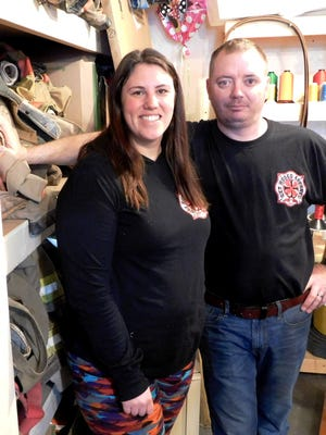 Staci and Jay Ernsberger operate Get Hosed Apparel as a home business turning old firefighters' gear into duffel bags, wallets, purses and more.