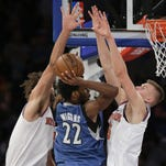 Minnesota Timberwolves guard Andrew Wiggins (22) looks to pass the ball off against New York Knicks center Robin Lopez, left, and forward Kristaps Porzingis (6) during the fourth quarter of an NBA basketball game Wednesday, Dec. 16, 2015, in New York. The Knicks won 107-102. (AP Photo/Julie Jacobson)