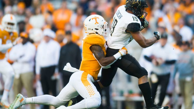 Tennessee defensive back Rashaan Gaulden (7) takes down Vanderbilt wide receiver C.J. Duncan during a game between Tennessee and Vanderbilt at Neyland Stadium in Knoxville, Tenn., on Saturday Nov. 25, 2017.