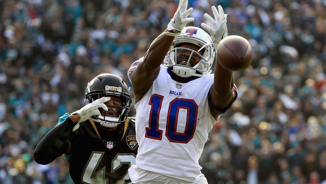 JACKSONVILLE, FL - JANUARY 07: Wide receiver Deonte Thompson #10 of the Buffalo Bills misses a fourth quarter pass as strong safety Barry Church #42 of the Jacksonville Jaguars defends in the fourth quarter during the AFC Wild Card Playoff game at EverBank Field on January 7, 2018 in Jacksonville, Florida.  (Photo by Mike Ehrmann/Getty Images)