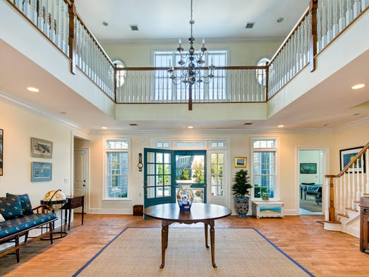 The two-story foyer with vaulted cathedral ceilings.