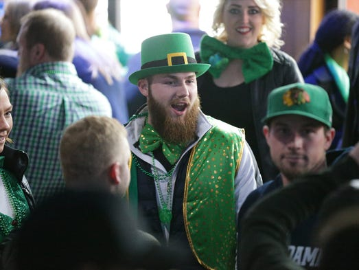 Revelers celebrate St. Patrick's Day weekend at Tiki