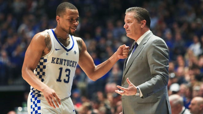 Kentucky's Isaiah Briscoe jokes with head coach John Calipari in the second half. Briscoe finished with 20 points as the Cats rolled past the Georiga Bulldogs 71-60 in Friday SEC quarterfinals in Nashville.